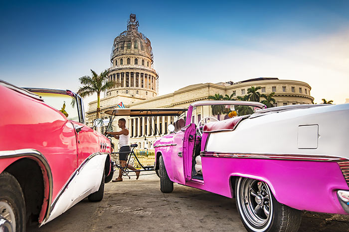 Havana's capitol and old cars.